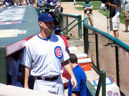 Cubs All-Star closer Kerry Wood peers out of the dugout.